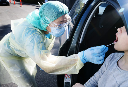 A nasal swab being taken for a COVID-19 test in Denmark