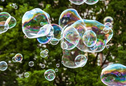 Photo of several colorful soap bubbles floating in the air