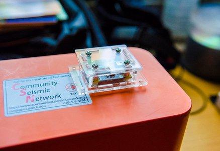 Closeup of an orange Community Seismic Network sensor