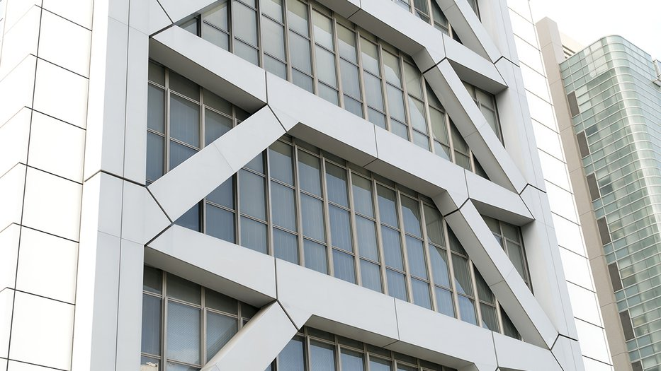 Close-up of a tall building with earthquake-resistant reinforcement in Japan