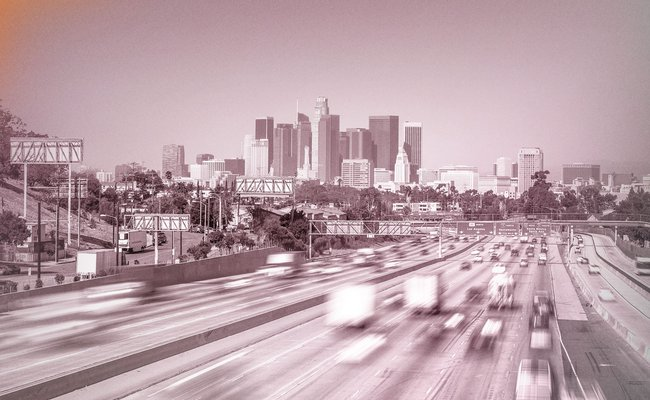 Time-lapse photo of Los Angeles traffic and skyscrapers