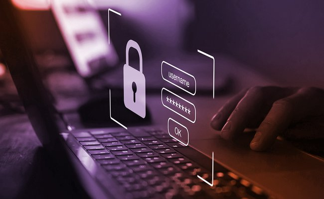 stylized photo of a person logging into a laptop with username and password and an image of a key