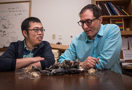 Tony Wang and Jess Adkins with samples of Desmophyllum dianthus fossils.