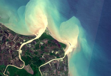 Satellite view of a river avulsion, whereby the river abruptly and catastrophically changed its course to the ocean.