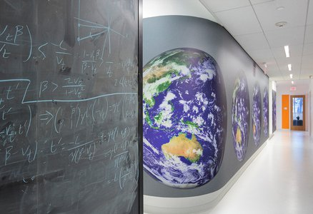 An image of a chalkboard and wall inside the Resnick Sustainability Institute building