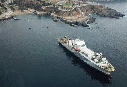 Large ship off a coastline