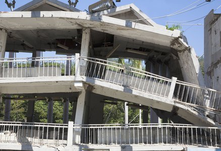 A concrete building collapses due to an earthquake