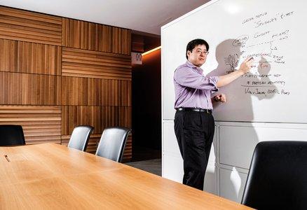 Sam Wang teaching at a Whiteboard
