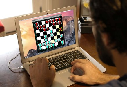 A laptop screen with a quantum chess game on it