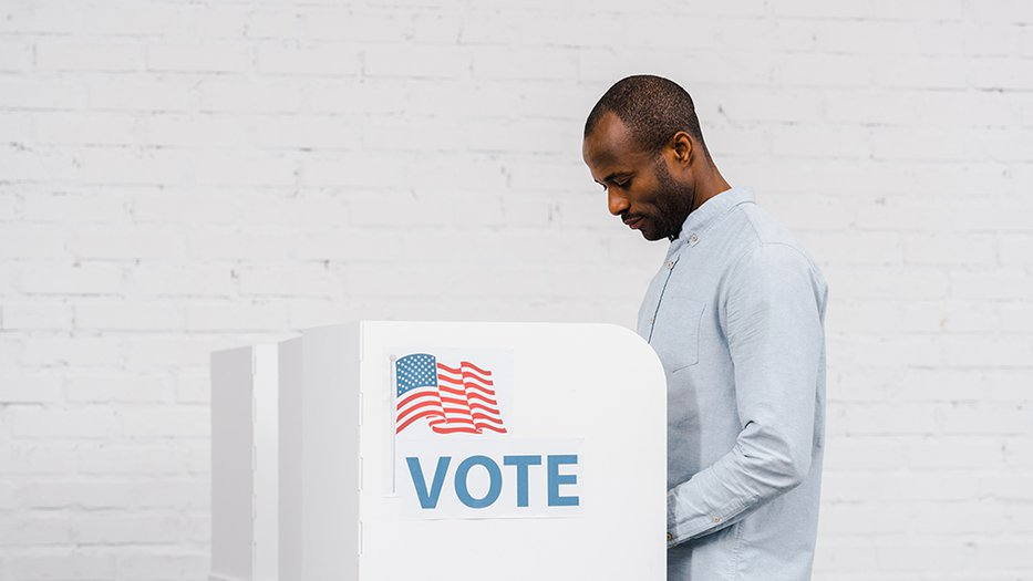 A man votes alone
