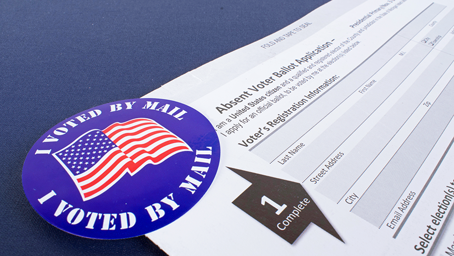 image of an I voted by mail sticker with American flag in the corner of a mail-in ballot