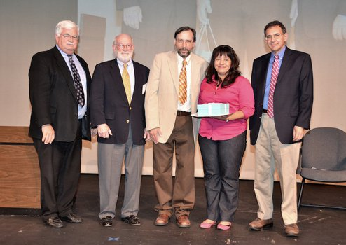 photo of Maria I. Lopez with Caltech dignitaries