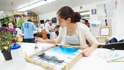 Student painting on canvas