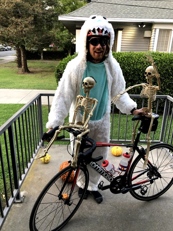 A fellow participant in a Halloween costume with skeletons on his bike.